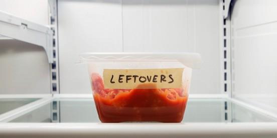 Single leftover container on refrigerator shelf