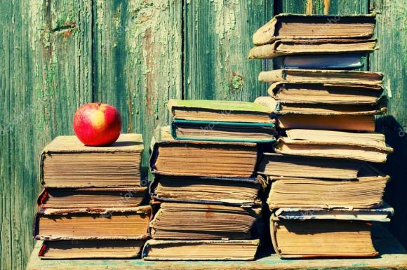 depositphotos_87761362-stock-photo-piles-of-old-books-and