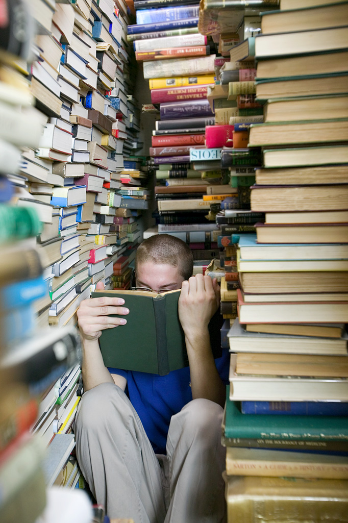 Image result for man covered in books
